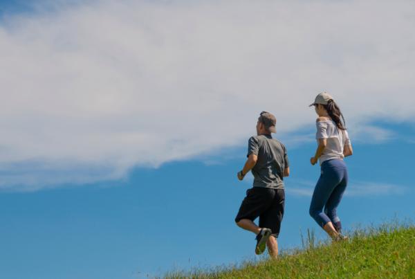 couple hiking downhill