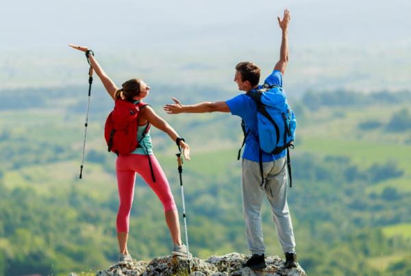 couple hiking to summit